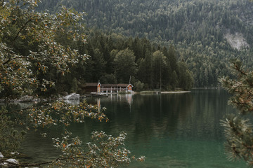 Cozy Boat House at a lake in the german Mountains framed by forest