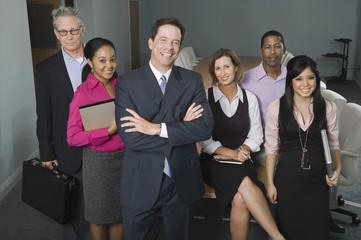 Group portrait of smiling multiethnic businesspeople