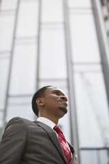 Confident African American businessman looking away