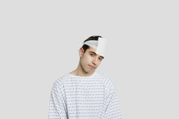 Sad male patient with bandage on head