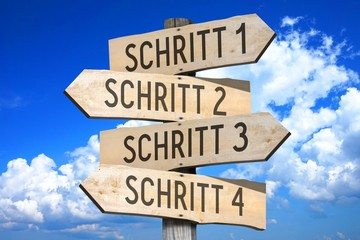 Schritt 1, Schritt 2, Schritt 3, Schritt 4 - German/ Step 1, Step 2, Step 3, Step 4 - English - wooden signpost