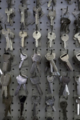 Large group of keys hanging on hooks in store