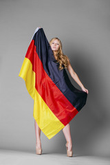 Young woman holds up a clear flag of Germany