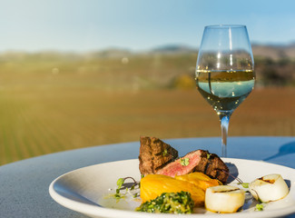 Steak and glass of white wine