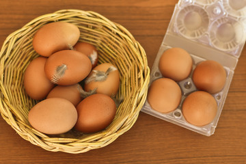 Fresh raw organic brown eggs in wicker basket prepare for packing to sell