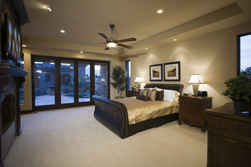 Dark wood furniture in bedroom with ceiling fan
