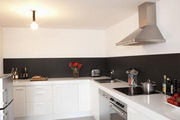 Minimalist kitchen with lit bare light