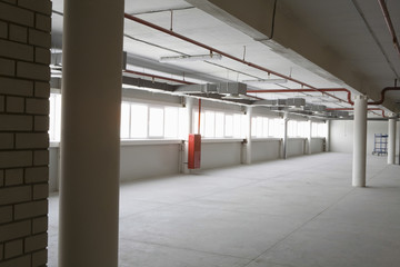 Large empty warehouse with windows