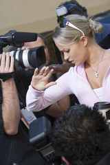 Closeup of a female celebrity and paparazzi