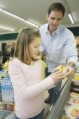 Father and daughter shopping together in a supermarket