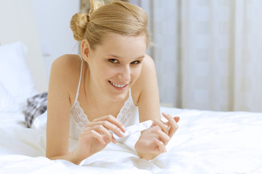 Young woman filing her nails
