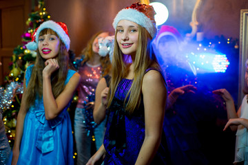Group of young girls celebrating Christmas. First plan