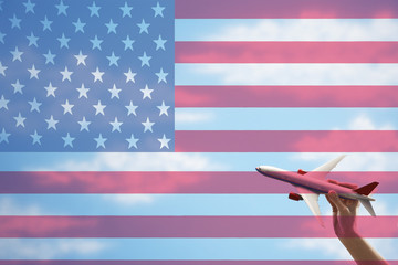 Toy plane flying in front of US flag