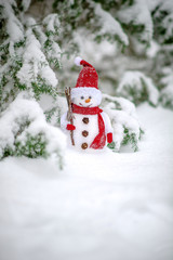 christmas toy of the snowman in snow covered forest    the  in