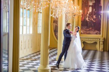 Full length of wedding couple dancing in church
