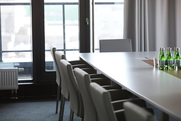 Chairs at conference table in modern office
