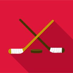 Hockey sticks and puck icon. Flat illustration of hockey sticks and puck vector icon for web design