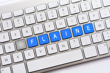 FLAINE writing on white keyboard with a snowflake sketch