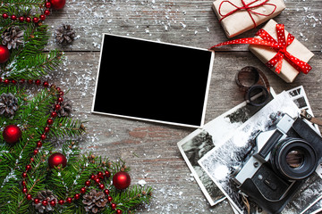 Vintage photo camera on christmas wooden background
