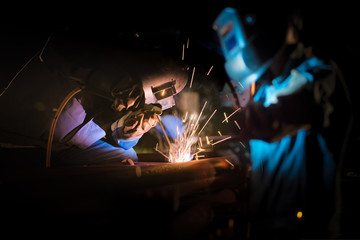 Welding at the industrial factory or steel production heavy industrial concept with Blur background of welder in construction work