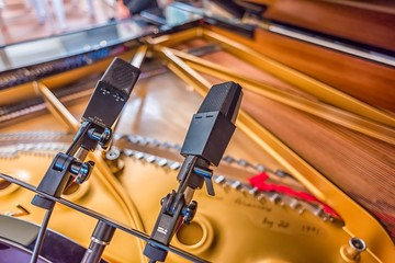 A pair of microphones in stereo for recording a grand piano