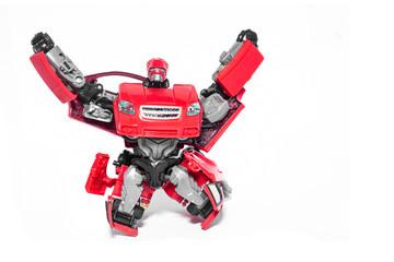 Robot battle transform car red on white background.