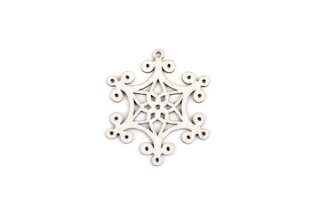 Gorgeous white wooden decoration - snowflake/ star. Adorable winter, Christmas, New Year, event decor made from solid wood. Isolated on white background. Top view. Closeup.