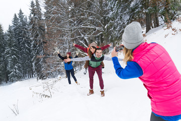 Woman Taking Photo On Smart Phone People Group Winter Snow Mountain Forest, Young Friends Christmas Holiday Vacation