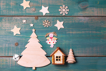 Christmas angel and star Shine on the Christmas tree and wooden house . by flying reindeer Santa
