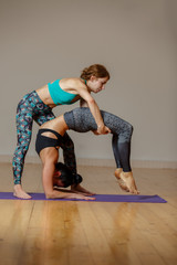 Two athletic women performing yoga