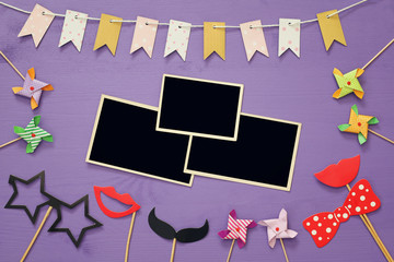 blank photo frames next to funny party accessories