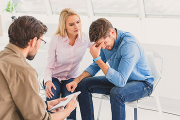 Dramatic couple in office of psychologist