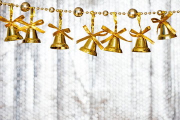 Set of golden bell on rod for decoration in christmas and new year