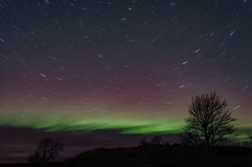 Northern lights (Aurora borealis) in the illuminated sky