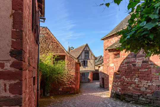 Old street of Collonges la Rouge on a sunny day