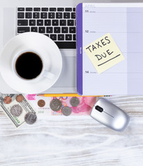 Tax season reminder with desktop work related objects