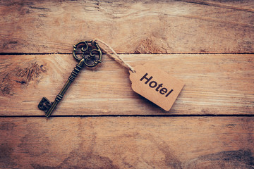 Business concept - Old key vintage on wood with tag Hotel.