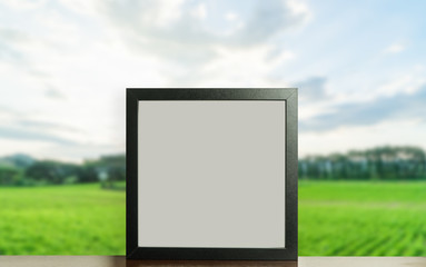 Square Blank photo frame with nature background.
