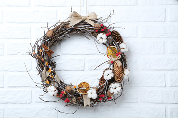 Christmas wreath on white brick wall background