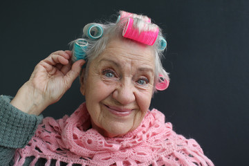 senior woman  in curlers