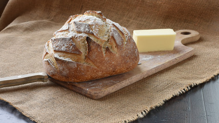 French artisan bread loaf on wood with burlap