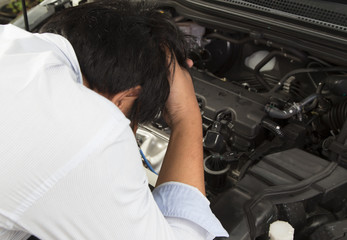 Young boy have stress about auto maintenance and no money for repair the car.