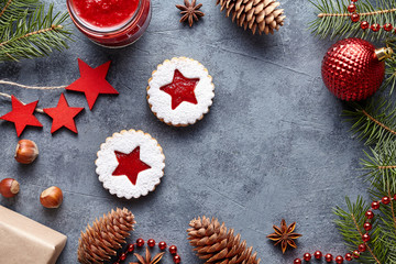 Linzer star cookies with jam filling traditional Christmas winter baked homemade Austrian sweet dessert food Xmas celebration pastry sugar powdered holiday snack on vintage background. Flat lay