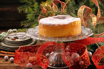 Christmas cheese cake on wooden background