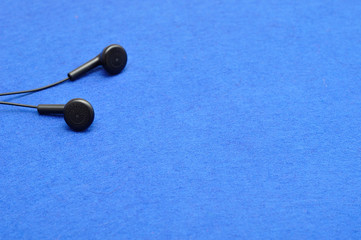 Earphones isolated against a blue background