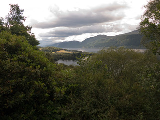 Trees and mountains surrounding Loch Ness
