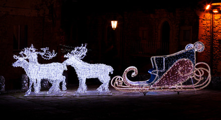 Christmas garland in the shape of reindeer and sleigh.