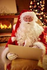 Christmas father in his living room with laptop