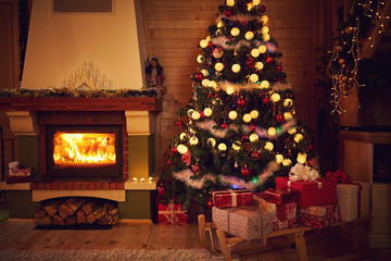 Christmas interior with fireplace and fir tree.