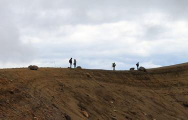 hikers standing on summit of tongariro alpine crossing
